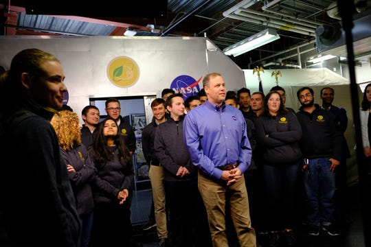 NASA Administrator Jim Bridenstine stands with University of Michigan students as they discussed the future of space exploration and UM's role in navigating the galaxy.