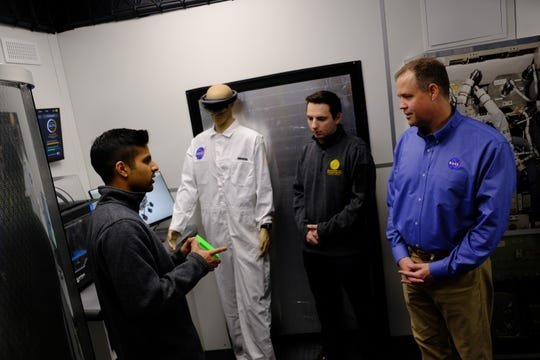 NASA Administrator Jim Bridenstine tours the University of Michigan Moon/Mars habitat with master students Amit Kothekar, left, and Alexander Sena, center, on Saturday, Oct. 26, 2019.