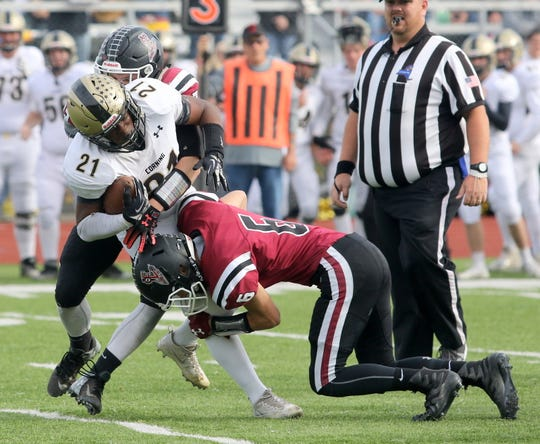 Ja'Ovian Fisher carries for Corning as Elmira's Ryan Gerow (6) makes the tackle Oct. 26, 2019 at Ernie Davis Academy.