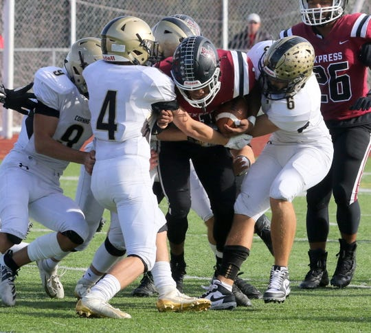 Corning's Kayden Snow (9), Noah Herberger (4) and Justin Rodriguez (6) tackle Elmira's Michael Brown during the Hawks' 8-0 win Oct. 26, 2019 at Ernie Davis Academy.