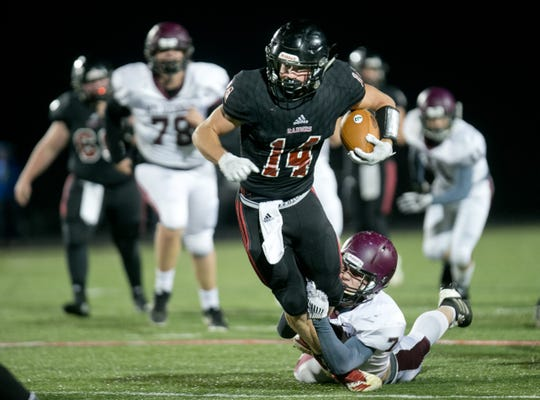 Brad Springer runs for a big gain in Southridge's 43-14 sectional opening victory over Mount Vernon on Friday evening in Huntingburg.