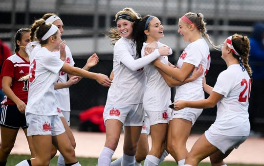 Este Bonnell (2), center, is congratulated by her Mater Dei teammates after scoring the first goal of the match in the Wildcats' 2-0 victory over South Dearborn in the Class 2A semistate Saturday at Bundrant Stadium.