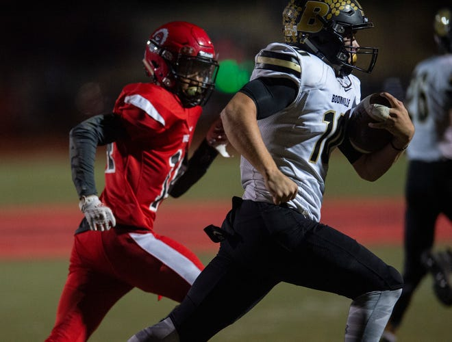 Boonville's Jackson Phillips (10) runs after intercepting a pass at the Harrison vs Boonville game at Harrison High School in Evansville, Friday, Oct. 25, 2019.
