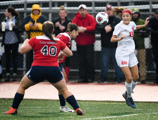 Mater Dei's Miranda Nosko (19) battles with South Dearborn's Katie Cutter (10) for the ball as the Mater Dei Wildcats play the South Dearborn Knights in the IHSAA soccer semi-state Saturday afternoon at Bundrant Stadium, October 26, 2019.