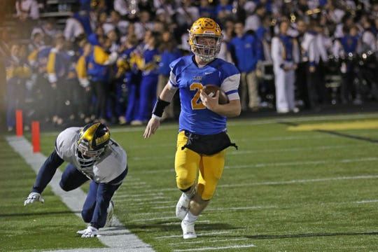 Clyde's Ryan Lozier races down the sideline.