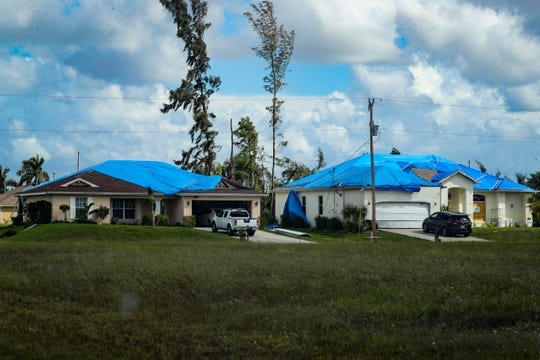 Residents in NW Cape Coral, that had home damage from last Saturday's tornado, live with blue and orange tarps on their homes as they wait for insurance adjusters. A few of the homes have been deemed inhabitable. A couple of homes had screen work being done on their pool cages late Saturday afternoon. October 26, 2019.