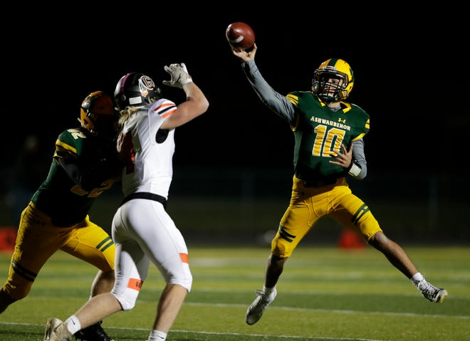Ashwaubenon High School quarterback Cadian Vang (10) throws a pass during a WIAA Division 3 first-round playoff game against Grafton on Friday.