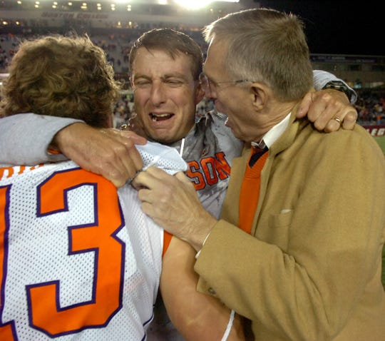 Clemson's interim head coach Dabo Swinney hugs Tyler Grisham (13) and athletics director Terry Don Phillips after the Tigers beat Boston College on Nov. 1, 2008.
