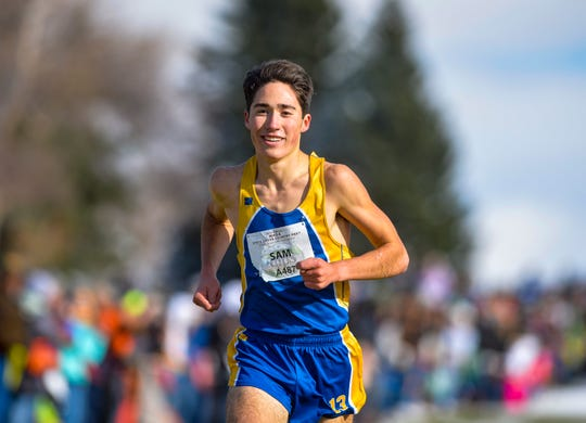 Lewistown's Sam Fulbright smiles as he finishes first in the boys' Class A race of the state cross country meet at Eagle Falls Golf Course on Saturday, Oct. 26, 2019.