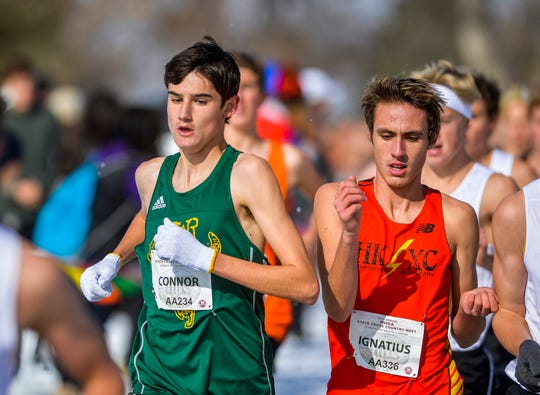 CMR's Connor O'Hara races next to Hellgate's Ignatius Fitzgerald during the Class AA race of the state cross country meet on Saturday at Eagle Falls Golf Course.