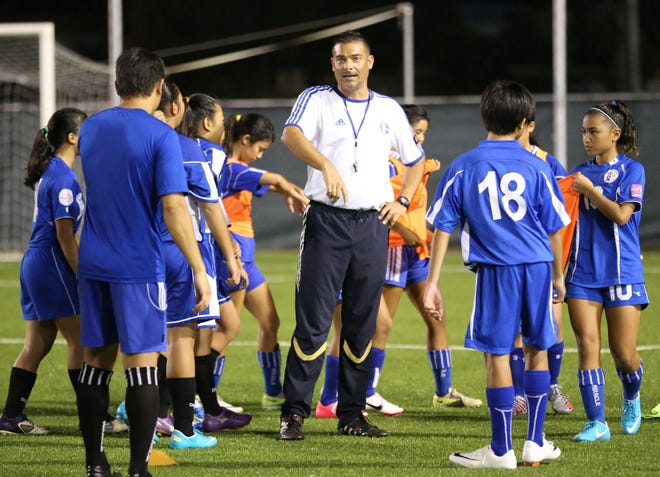 """Duane Pahl organizes a training session with youth national players during an AFC """"C"""" Coaching Certificate Course at the Guam Football Association National Training Center in this file photo."""