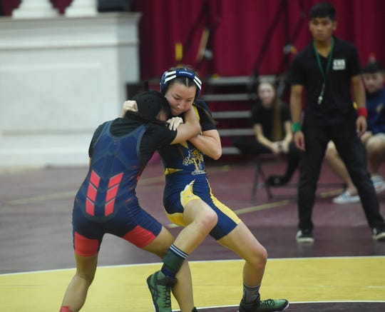 Guam High and Okkodo wrestlers showcase skills during their IIAAG wrestling match at the Father Duenas Memorial School Phoenix Center, Mangilao, Oct. 26, 2019.
