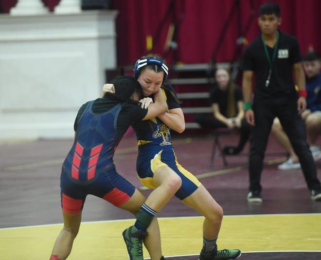 Guam High and Okkodo wrestlers showcase skills during their IIAAG wrestling match at the Father Duenas Memorial School Phoenix Center, Mangilao, Oct. 26, 2019.