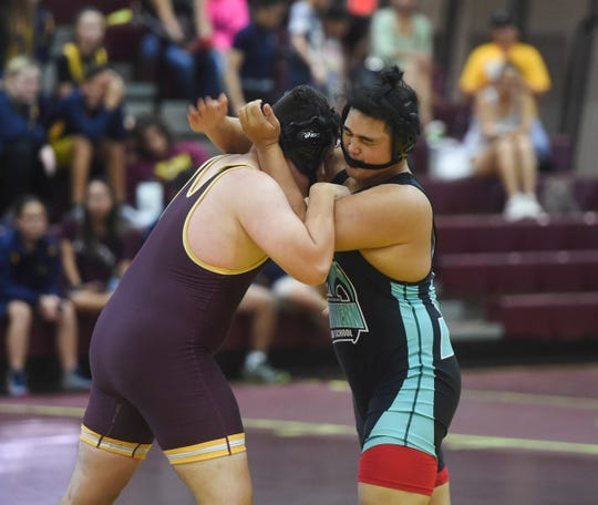 Southern High School and Father Duenas Memorial School wrestlers tie up during their IIAAG wrestling match at the Father Duenas Memorial School Phoenix Center Oct. 26. Although DOE will have its own sports league in the spring, Superintendent Jon Fernandez has invited IIAAG to participate in interleague play.