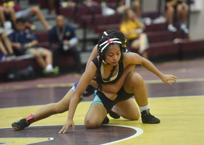 Academy's Athyllia San Gil takes the back of Southern High wrestler Asia Topasna during their IIAAG Wrestling match at the Father Duenas Memorial School Phoenix Center, Mangilao, Oct. 26, 2019.