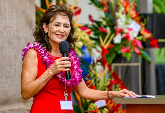 Kathy Calvo, Pay-Less Markets Inc. president, speaks during a ribbon cutting ceremony held to celebrate the grand opening of Pay-Less Supermarket's newest store in Maite on Saturday, Oct. 26, 2019.