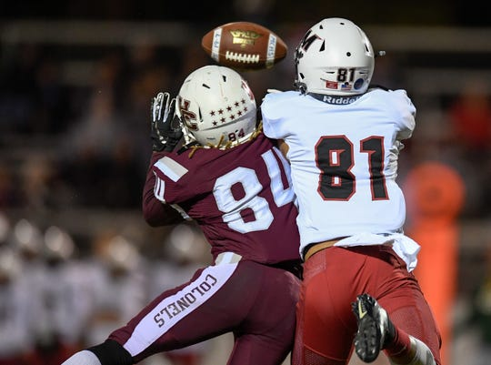 Henderson's Jaheim Williams (84) and McCracken County's Zander Mayes (81) go up for a ball intended for Mayes as the Henderson County Colonels play the McCracken County Mustangs at Colonel Stadium Friday evening, October 25, 2019.