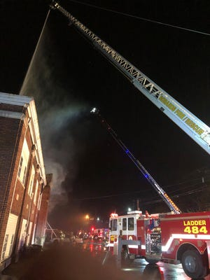Both aerial ladder trucks in the county -- a new one from the city and the city's old one, which was donated to Robards VFD -- were used to put out the fire at the old Weaverton Grade School building early Saturday morning.