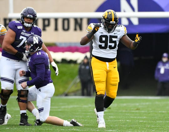 Oct 26, 2019; Evanston, IL, USA; Iowa Hawkeyes defensive lineman Cedrick Lattimore (95) reacts after he sacked Northwestern Wildcats quarterback Aidan Smith (11) in the first half at Ryan Field. Mandatory Credit: Matt Marton-USA TODAY Sports