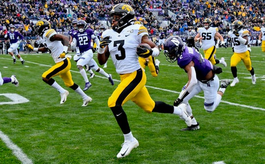 Tyrone Tracy Jr. races up the left sideline after escaping Northwestern defenders on his way to a 50-yard touchdown in the first quarter.
