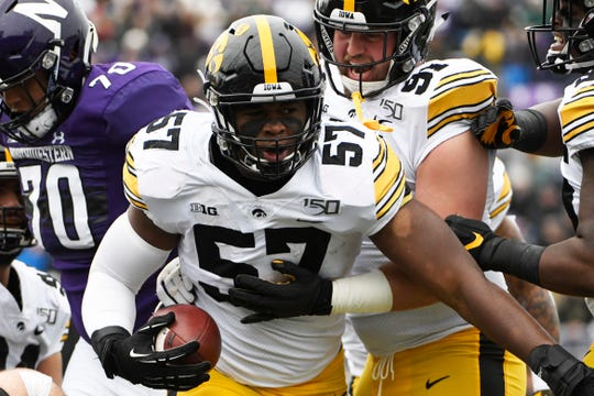Iowa defensive end Chauncey Golston (57) reacts after intercepting a pass against Northwestern during the first half of an NCAA college football game, Saturday, Oct. 26, 2019, in Evanston, Ill. (AP Photo/David Banks)