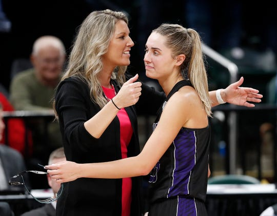 Northwestern's Madison Layden gets a hugs from her coach and mom Kathie Layden in the final minutes of their Class 3A State Championship win at Bankers Life Fieldhouse, Feb 23, 2018.