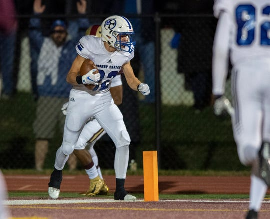 Bishop Chatard High School senior Andrew Sowinski (22) reacts after scoring a touchdown during the first half of action. Brebeuf Jesuit Preparatory High School hosted Bishop Chatard High School in IHSAA sectional football action, Friday, Oct. 25, 2019.