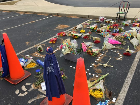 Classmates and friends placed flowers on Jacob James' parking spot at Waldron High School.