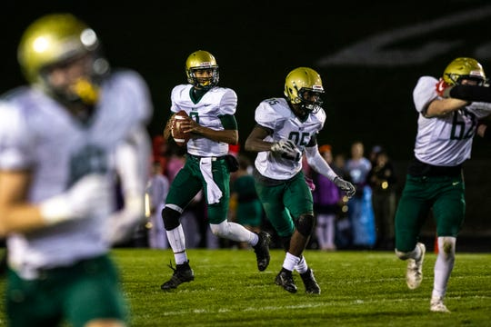 Iowa City West quarterback Marcus Morgan (2) rolls out to pass during a Class 4A varsity football game in the Battle for the Boot, Friday, Oct., 25, 2019, at Frank Bates Field in Iowa City, Iowa.