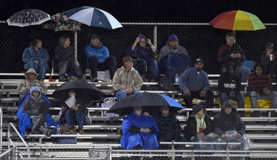 Neshoba Central fans braved the weather on Friday, October 25, 2019, at Ridgeland High School in Ridgeland, Miss. More rain and wind was expected through much of Saturday in much of Mississippi.