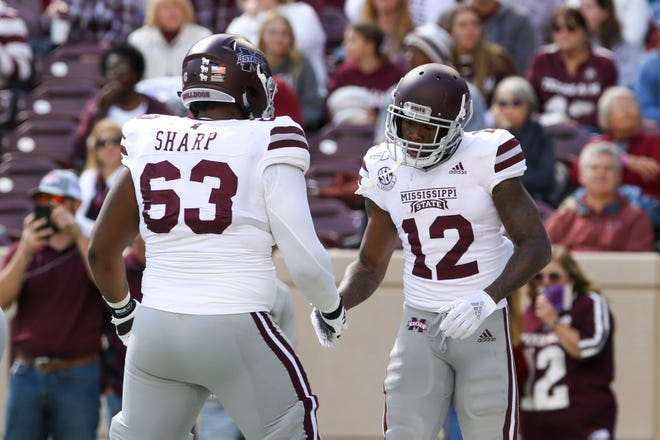 Oct 26, 2019; College Station, TX, USA; Mississippi State Bulldogs wide receiver Isaiah Zuber (12) celebrates with offensive lineman LaQuinston Sharp (63) after a Zuber touchdown during the third quarter at Kyle Field. Mandatory Credit: John Glaser-USA TODAY Sports