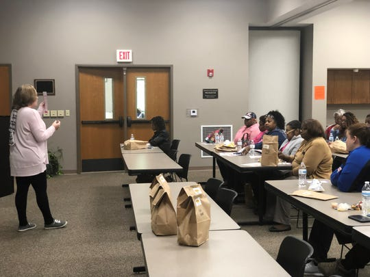 Amanda Johnson, the public health educator at the Jackson-Madison County Regional Health Department, discusses breast cancer at a Lunch and Learn Wednesday.
