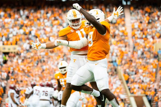 Tennessee linebacker Henry To'o To'o (11) and Tennessee linebacker Darrell Taylor (19) react after a play during a game between Tennessee and South Carolina at Neyland Stadium in Knoxville, Tennessee on Saturday, October 26, 2019.