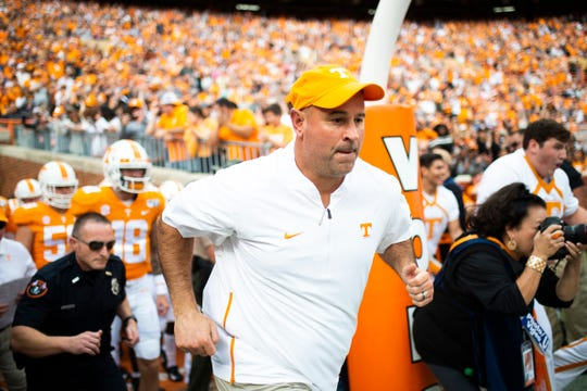 Tennessee Head Coach Jeremy Pruitt takes the field during a game between Tennessee and South Carolina at Neyland Stadium in Knoxville, Tennessee on Saturday, October 26, 2019.