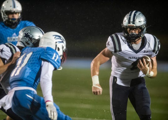 Farragut's Alec Keathley (1) prepares to meet Hardin Valley's Treston Thomas (11) during the Hardin Valley and Farragut game on Friday, October 25, 2019 at Hardin Valley Academic.