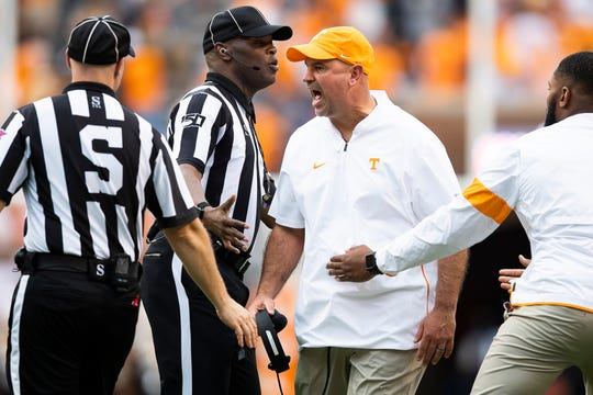 Tennessee Head Coach Jeremy Pruitt  argues a call against Tennessee defensive lineman Darel Middleton (97) before Middleton is ejected during a game between Tennessee and South Carolina at Neyland Stadium in Knoxville, Tennessee on Saturday, October 26, 2019.