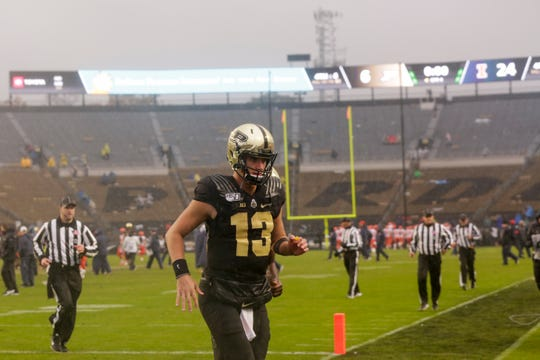Purdue quarterback Jack Plummer (13) jogs off the field after Illinois defeated Purdue, 24-6, Saturday, Oct. 26, 2019 at Ross-Ade Stadium in West Lafayette.