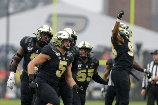 Purdue defensive end George Karlaftis (5) celebrates a sack during the first quarter of a NCAA football game, Saturday, Oct. 26, 2019 at Ross-Ade Stadium in West Lafayette.