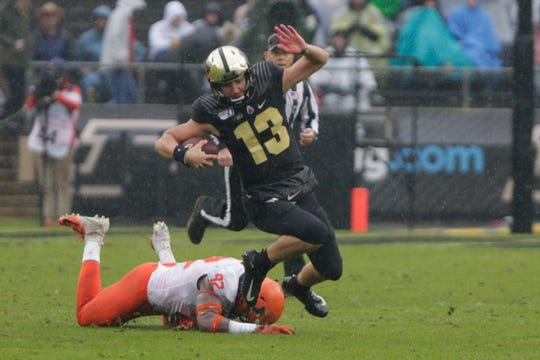 Purdue quarterback Jack Plummer (13) runs the ball after dodging Illinois defensive lineman Isaiah Gay (92) during the second quarter of a NCAA football game, Saturday, Oct. 26, 2019 at Ross-Ade Stadium in West Lafayette.