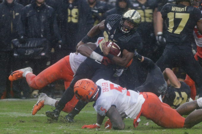 Illinois defensive lineman Isaiah Gay (92) and Illinois linebacker Milo Eifler (5) tackle Purdue running back Tario Fuller (25) during the fourth quarter of a NCAA football game, Saturday, Oct. 26, 2019 at Ross-Ade Stadium in West Lafayette.