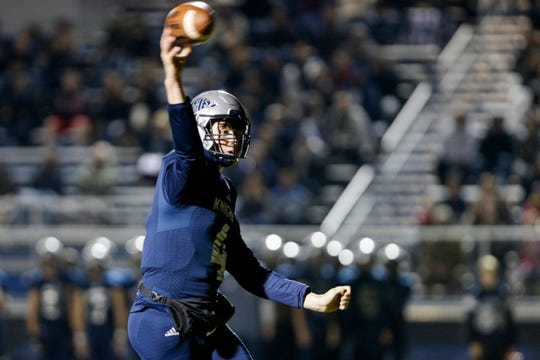 Central Catholic's Clark Barrett (4) throws during the first quarter of an IHSAA football game, Friday, Oct. 25, 2019 in Lafayette.