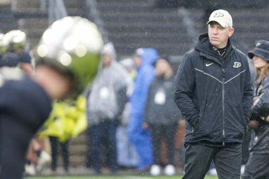 Purdue head coach Jeff Brohm watches warm up prior to a NCAA football game between the Purdue Boilermakers and the Ilinois Fighting Illini, Saturday, Oct. 26, 2019 at Ross-Ade Stadium in West Lafayette.
