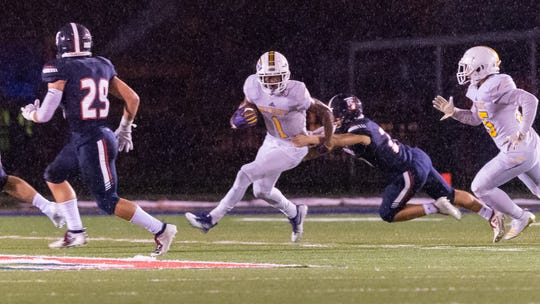 Kayshon Boutte runs the ball as Teurlings takes on Westgate in the rain.  Friday, Oct. 25, 2019.