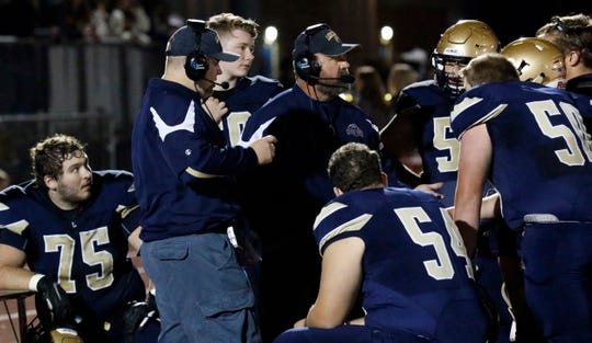 Lancaster assistant coach Tony Albertini talks with the Golden Gales' offensive lineman during their game last week. They will travel to Reynoldsburg on Friday to face the Raiders.