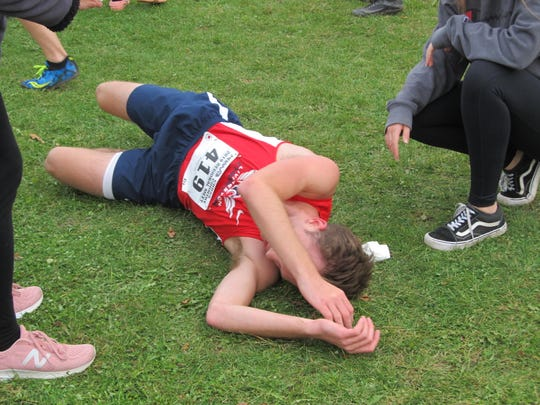 Levi Hinkle-DeGroot of Livingston Christian gave everything he had to earn a trip to the state cross country meet.