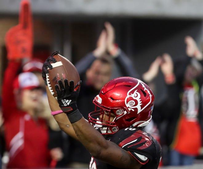Louisville's Javain Hawkins celebrates scoring a touchdown against Virginia on Oct. 26, 2019.