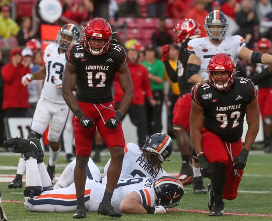 Louisville's Marlon Character celebrates after sacking the quarterback on Oct. 26, 2019.