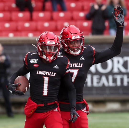 Louisville's Tutu Atwell (#1) celebrates with Dez Fitzpatrick after scoring a touchdown against Virginia on Oct. 26, 2019.