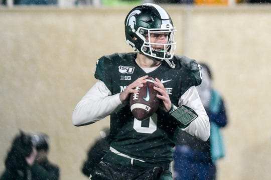 Theo Day looks to throw during the fourth quarter Saturday.