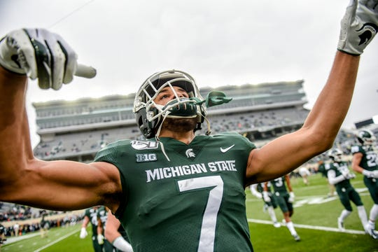 Michigan State receiver Cody White pumps up the crowd before the Spartans game against Penn State on Saturday, Oct. 26, 2019, at Spartan Stadium in East Lansing.